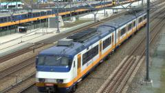 A 3 carriage electric train (with audio) in Arnhem, Netherlands. - stock footage