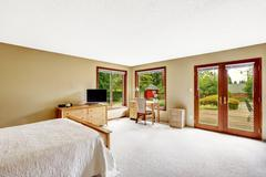Bedroom with walkout basement deck Stock Photos