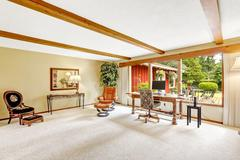 Luxury log cabin house interior. living room with office area Stock Photos
