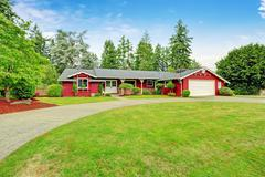 beautiful red house with garage and curb appeal - stock photo
