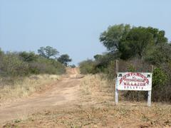 Stock Photo of bolivian sign for welcoming people at the deserted border between paraguay an