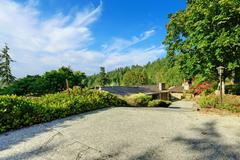 house with uphill driveway - stock photo