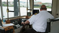 Riverboat captain in wheelhouse Stock Footage