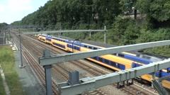 Double decker local train (handheld with audio) in Arnhem, Netherlands. Stock Footage