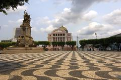 Square with mosaic meeting of the waters and teatro amazonas opera house, man Stock Photos