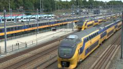 A pair of Intercity double decker (with audio) trains in Arnhem, Netherlands. Stock Footage