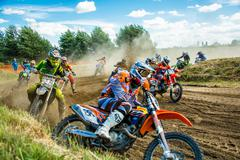 Motocross riders on the race Stock Photos