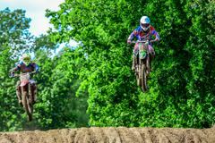 Motocross rider on the race Stock Photos