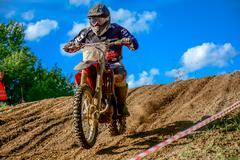 motocross rider on the race - stock photo