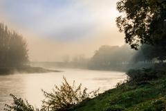 Fog in autumn on the river Stock Photos