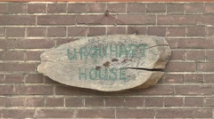 Sign outside house where Gen. Urquhart hid during Operation Market Garden. Stock Footage