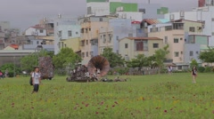 Pier 2 art center - field outside with flower bed and art structure Stock Footage