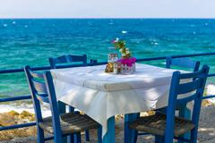 tavern by the sea in greece - stock photo