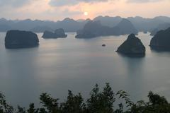 sunset in the unesco-declared world natural heritage halong bay viet nam - stock photo