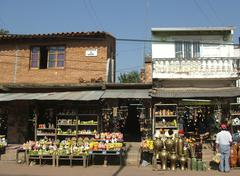 houses with shops and their exhibitions of colorful and trashy figurines at t - stock photo