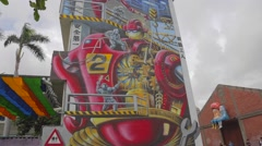 Pier-2 Art Center - iron man Taiwan medium pan Stock Footage