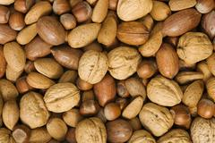 Mixed nuts with walnuts, hazelnuts, almonds and pecan nuts Stock Photos