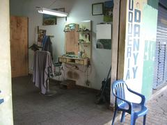 Stock Photo of typical tiny barber shop in luque near asuncion, paraguay