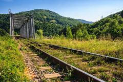 Rail metal bridge in mountains Stock Photos