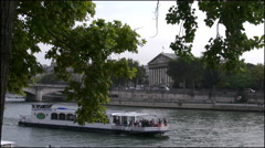 Paris National Assembly beyong boat going by 4k Stock Footage