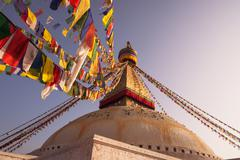 Prayer flags and boudhanath stupa in kathmandu Stock Photos
