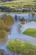 Flood in spring with awashed grassland and meadows, lahn valley, hessen, germ Stock Photos