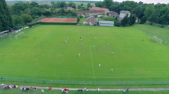 Stock Video Footage of Aerial of soccer match on green lawn