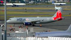 JetBlue Red Sox airplane departure Stock Footage
