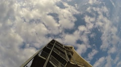 View of the moving clouds on a background of the tower, timelapse Stock Footage