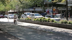 Cyclist biking on bike lane in downtown Vancouver Stock Footage