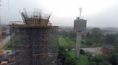 New water-tower beside the old small one Stock Footage