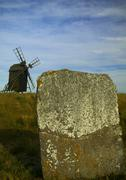 Runestone and windmill, island oland, sweden Stock Photos