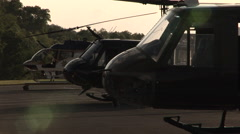 Helicopters lined up at helipad Stock Footage