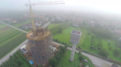 High over construction site with water-tower Stock Footage