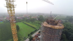 Flying beside the crane building water-tower Stock Footage