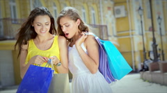 Young beautiful girlfriend emotionally look into shopping bags after shopping Stock Footage