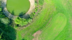 Aerial over golf player going to a bridge Stock Footage