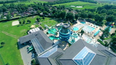 Aerial of aquapark with pool and slide - stock footage