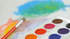 Watercolors, painting and brush on the desk, art, expression, camera movement - stock footage