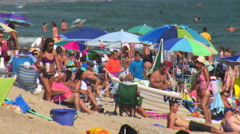 Misquamicut beach, rhode island in summertime in extreme telephoto shot Stock Footage