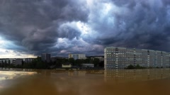 Silhouette of an evening city with thunderclouds, timelapse Stock Footage