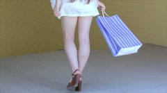 Young cheerful girl shopaholic posing with shopping bag - stock footage