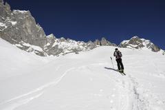 Stock Photo of Skier on his way to Toerl Grat Pass, Wilder Kaiser Range, Tirol, Austria, Europe