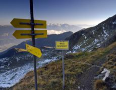 "directional sign and ""weg gesperrt"" (trail closed) sign, mt. kellerjoch, schw - stock photo"