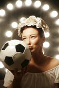football goddess kissing a football - stock photo
