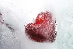 heart frozen in a block of ice: cold-hearted - stock photo