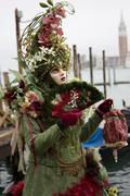 Red and green costume and mask, carnevale di venezia, carneval in venice, ita Stock Photos