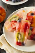 Healthy whole fruit popsicles Stock Photos