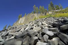 Broken-off pieces of basalt columns at mammoth lake, devil\'s postpile nation Stock Photos