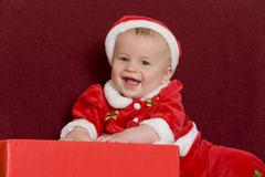 6-month-old little boy wearing santa claus costume Stock Photos